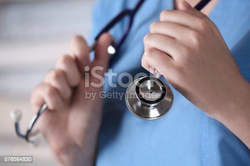 istock phonendoscope in doctor arm 576564830