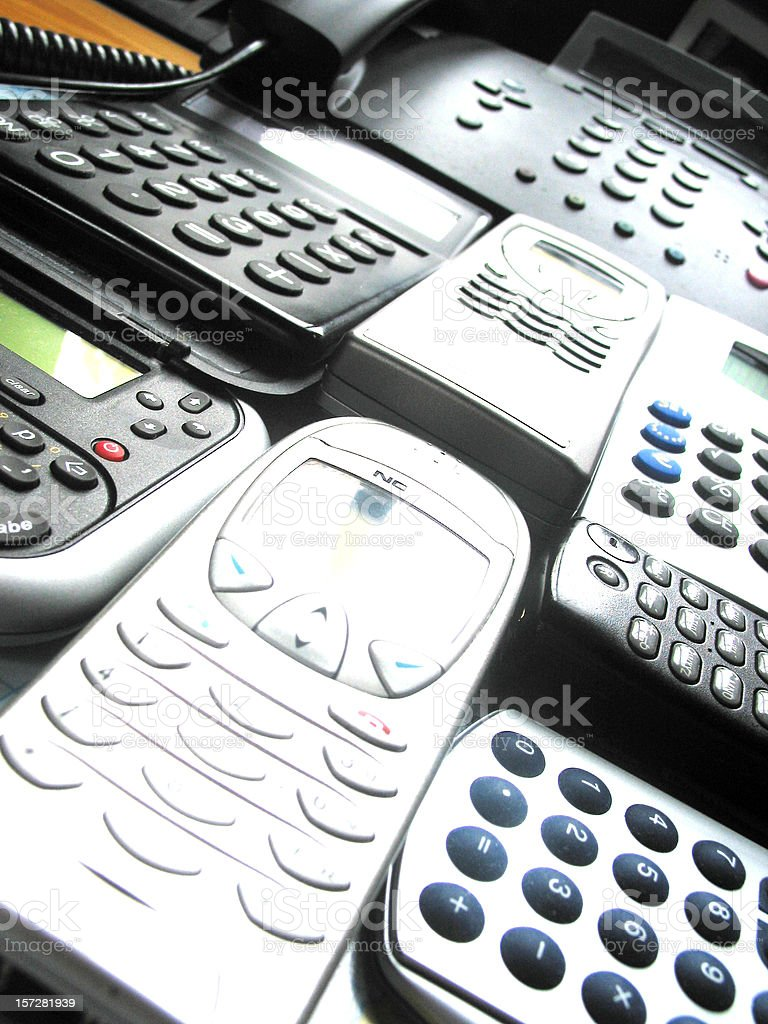 Phones and calculators in a row royalty-free stock photo