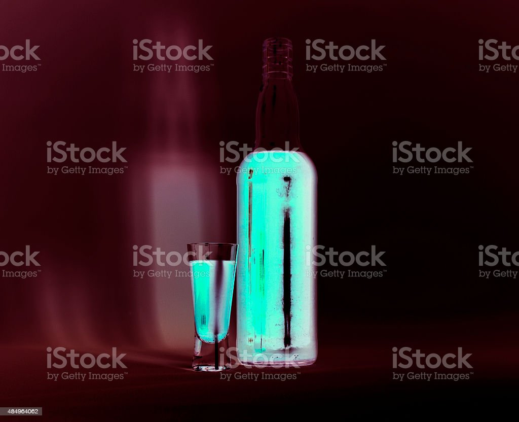 Phosphorescent glass and bottle stock photo