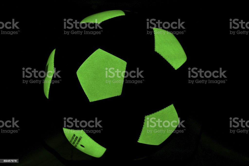 Phosphorescent soccer ball in the dark stock photo