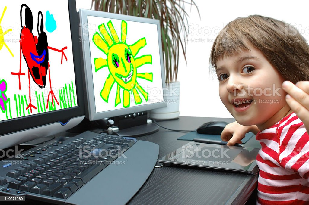 Photo a little girl draws at the computer stock photo