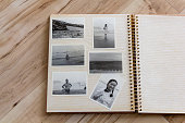 istock Photo album, old black-and-white photograph of Japanese couple shot in around 60's. Wooden background. 1291565905
