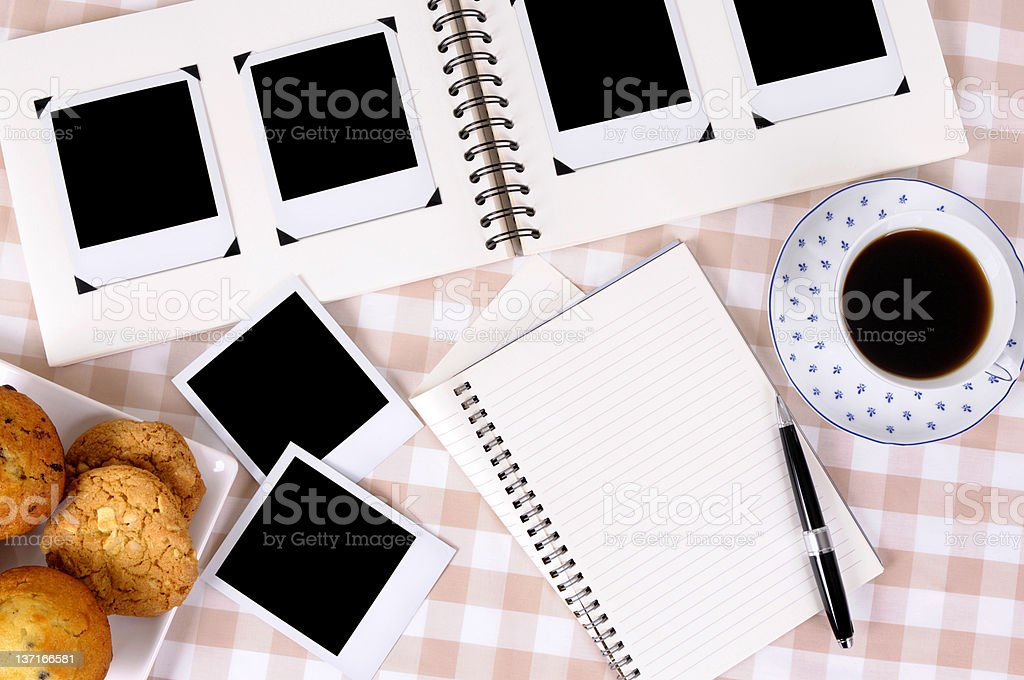 Photo album with coffee and notebook royalty-free stock photo