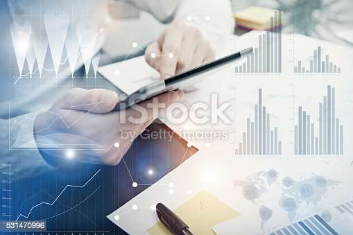 533699494istockphoto Photo Analytics Department working Market Charts.Banker Manager work process 531470996