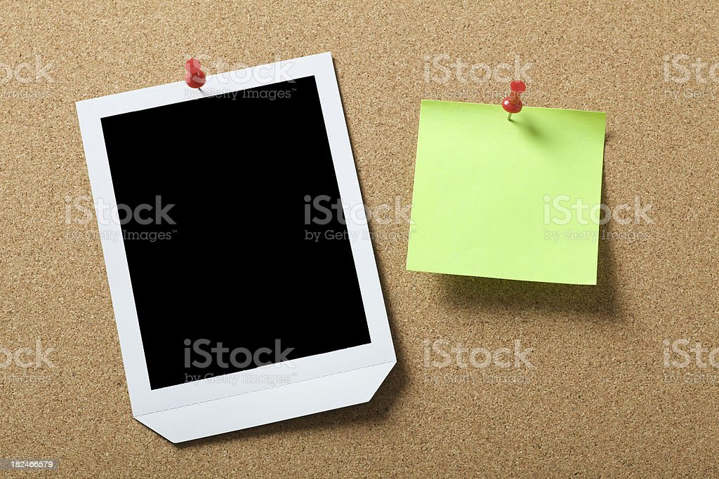 Photo and sticky note on the corkboard royalty-free stock photo