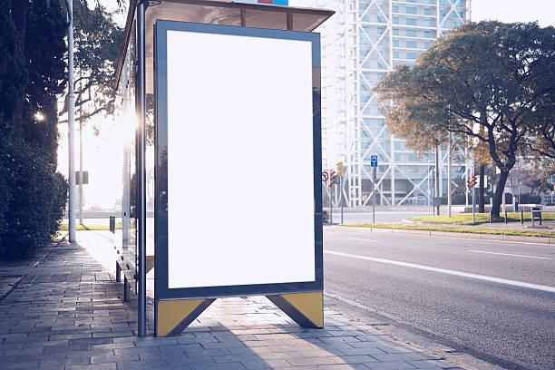 photo blank lightbox on bus stop in the modern city - bushalte stockfoto's en -beelden