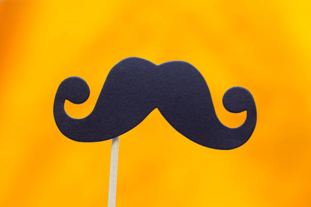 Photo booth props black Mustache against yellow background stock photo