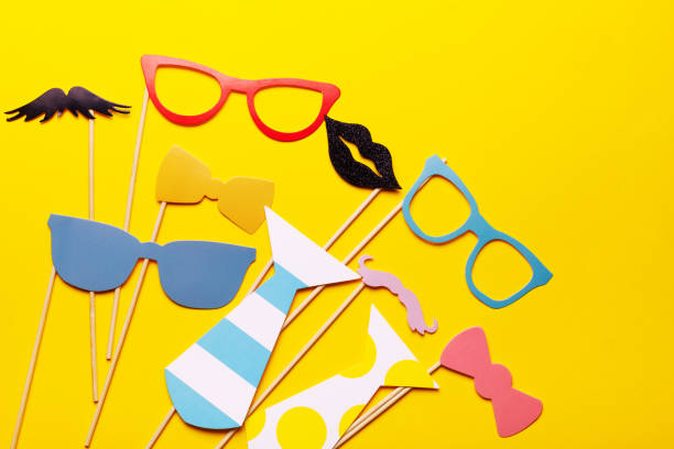 Photo booth props glasses, mustache, lips on a pink background flat lay. Birthday parties and weddings. stock photo