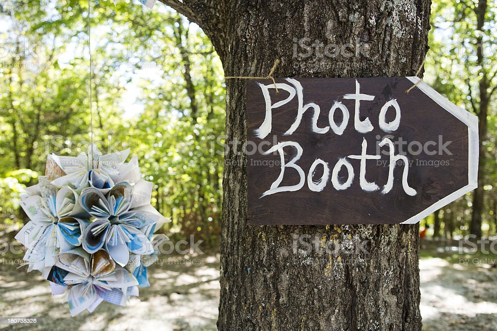 Photo booth sign at outdoor wedding stock photo