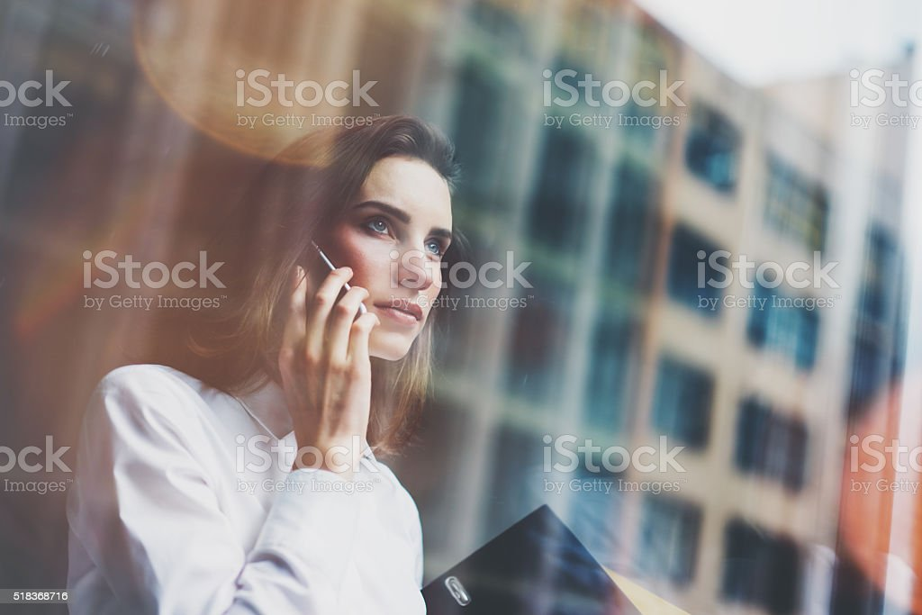 Photo business woman wearing modern white shirt, talking smartphone and stock photo