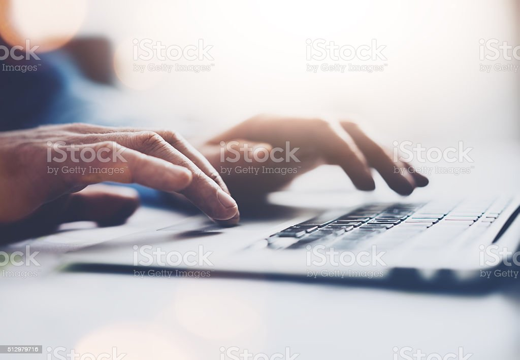 Photo businessman working with generic design notebook. Typing message, hands stock photo