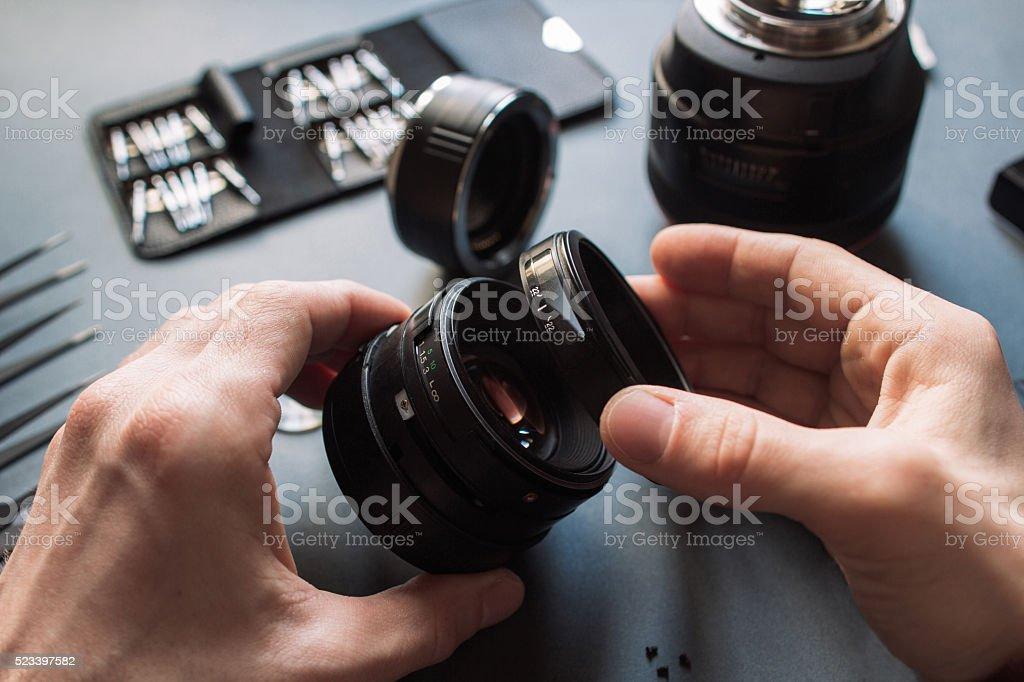 Photo camera lens repair set. Technician engineer stock photo