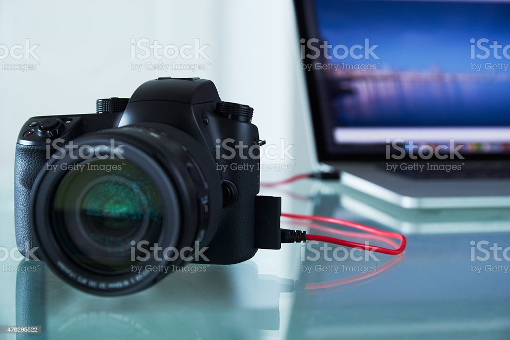 DSLR Photo Camera Tethered To Laptop Computer With USB Cable stock photo