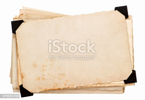 1129542015 istock photo photo card with black corner. old grungy paper sheets 470234703