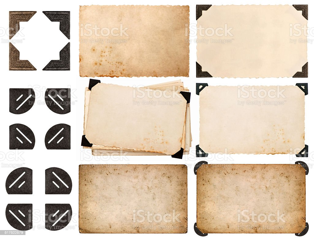 photo corner, old photo card, aged paper isolated on white stock photo