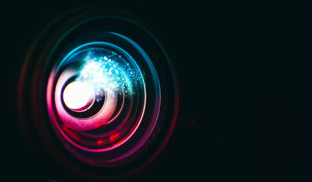 photo depicts digital projector film presentation. projector shiny colorful glass lens closeup, macro view, black background. - comunicazione multimediale foto e immagini stock