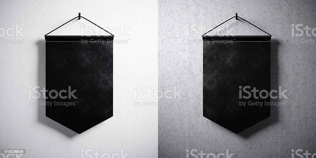 Photo double black pennant hanging on concrete wall. High detailed stock photo