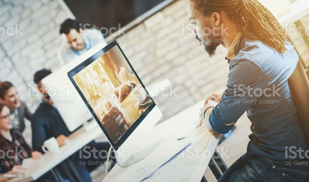 Photo editor working at office. stock photo