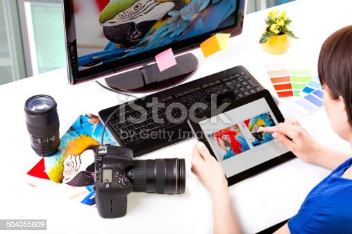 istock Photo editor working on computer. 504055609