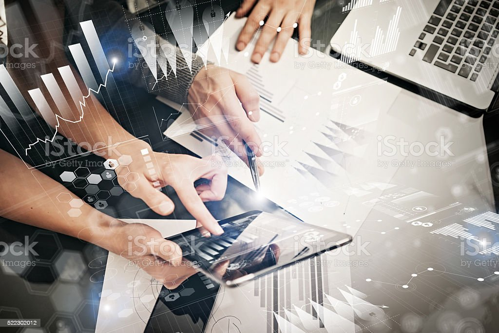 Photo female hands holding modern tablet and touching screen.Businessmans stock photo