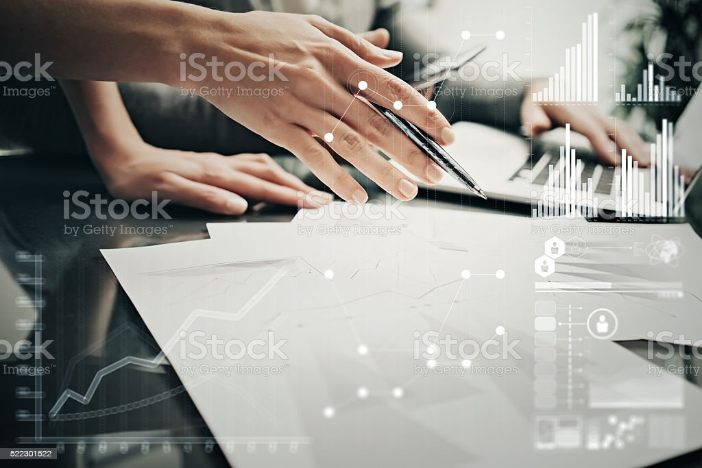 Photo female hands with pen.Businessmans crew working investment project stock photo