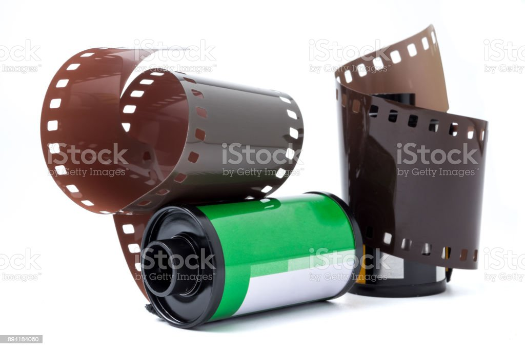 Photo film in cartridge, Photographic roll film 35 mm on a white background. stock photo