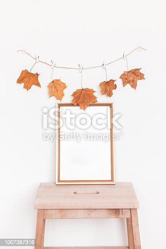 istock Photo frame, autumn garland on white background. Front view 1007387316
