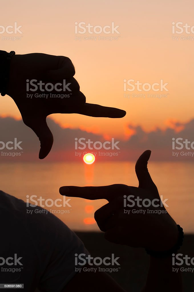 Photo frame hands stock photo