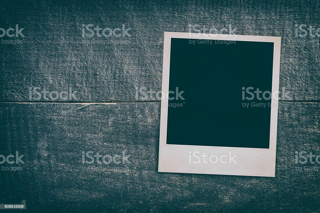 Photo frame on vintage wooden texture. stock photo