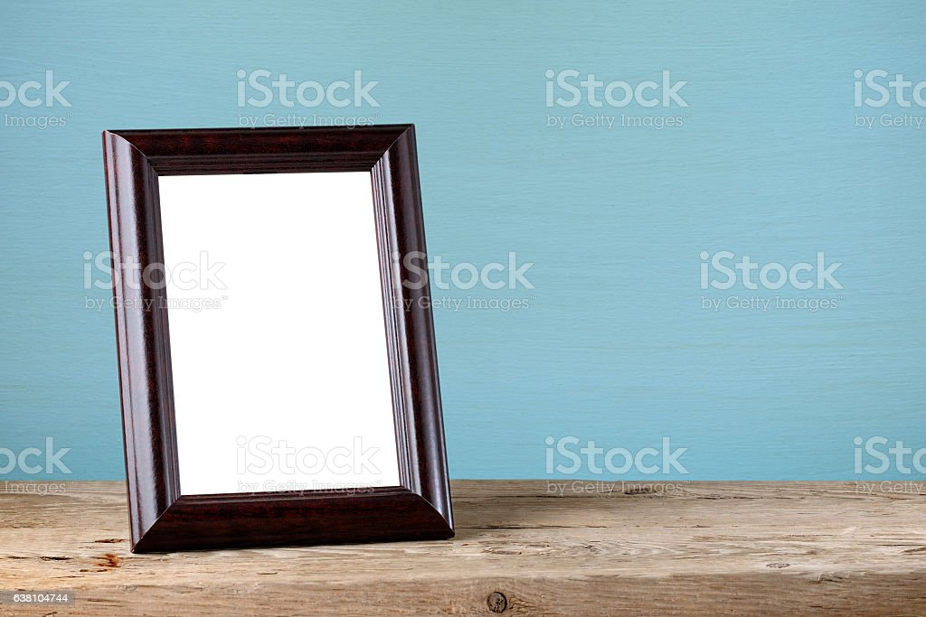 Photo frame on wooden table stock photo