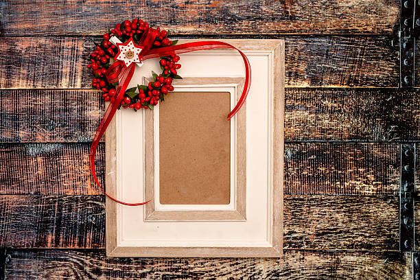 Photo frame over wooden background stock photo