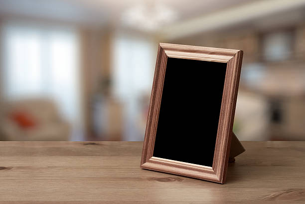 Royalty Free Picture Frames On Table Pictures, Images and Stock ...
