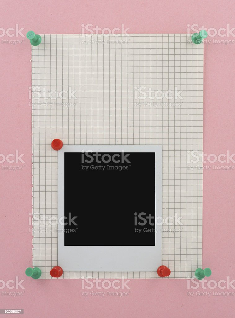 Photo frame pinned to a piece of squared paper royalty-free stock photo