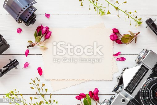istock Photo frame, retro camera and photo film rolls 539113172