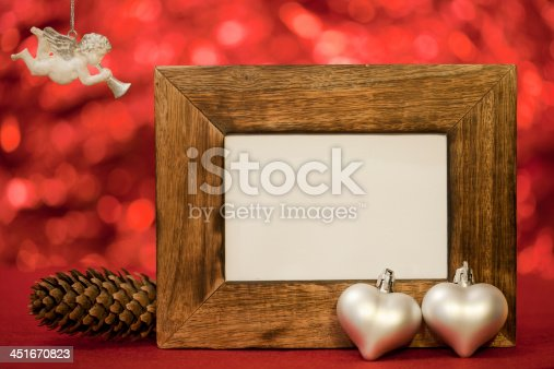 istock photo frame with hearts ornaments and angel singing 451670823