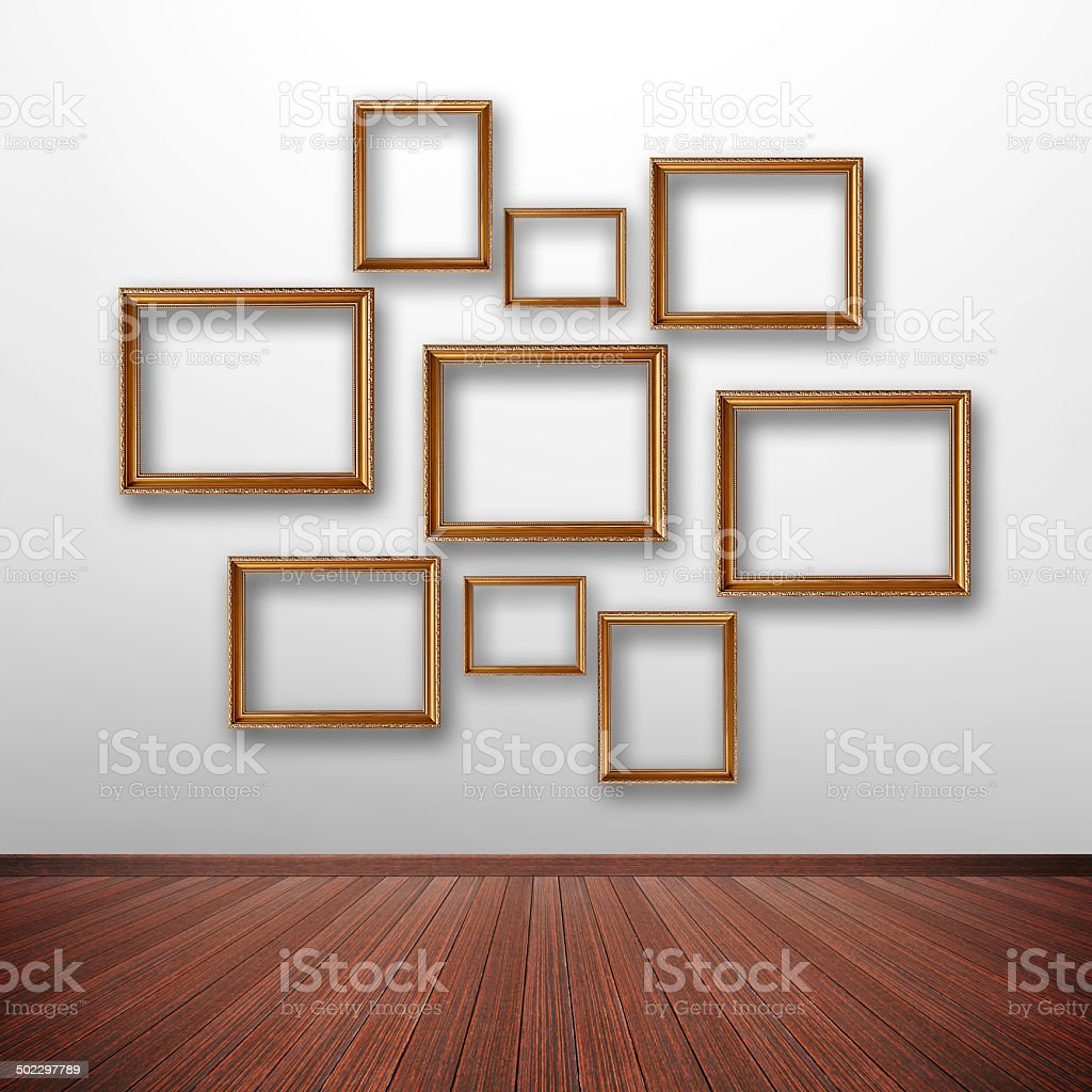 Photo frames on the wall inside the room royalty-free stock photo