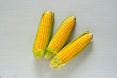 fresh corn and a billboard with a natural and simple design, please use with your needs
