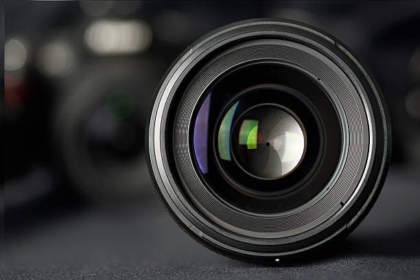 photo lens front view on blurred camera - aperture stock pictures, royalty-free photos & images