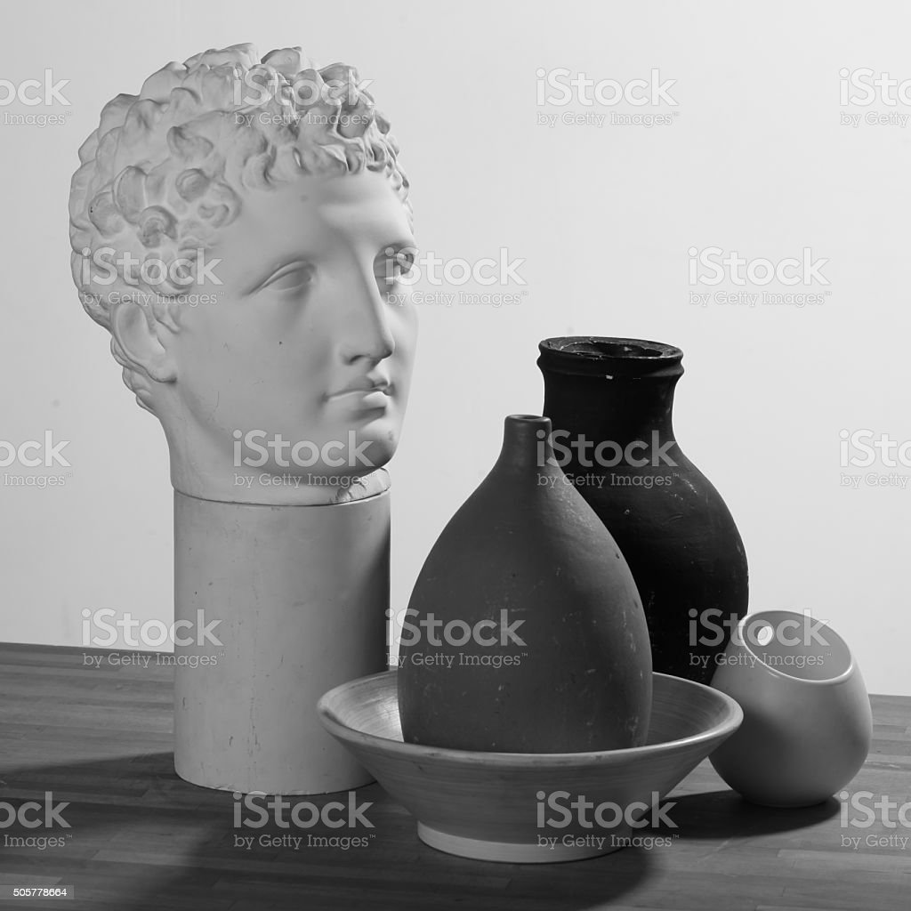 Photo lesson, plaster head and vases, three light sources stock photo