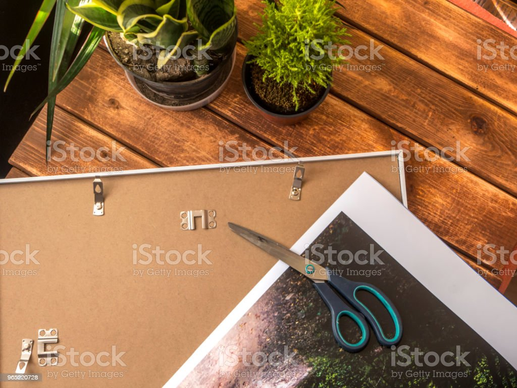 photo lying on a frame on a wooden surface royalty-free stock photo
