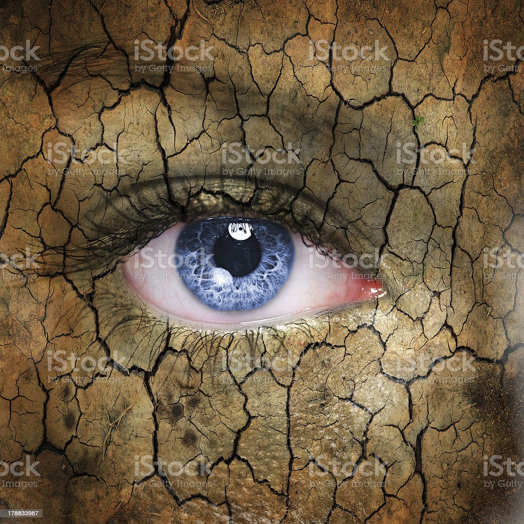 Photo manipulation of blue eye and earthy, cracked skin stock photo
