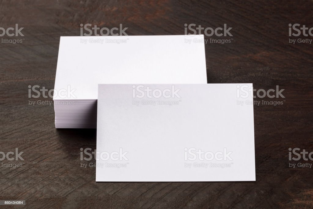 Photo mockup of blank white business card with stack stock photo