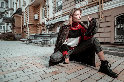 istock Photo model wearing nice clothes posing outside the street 1070225102