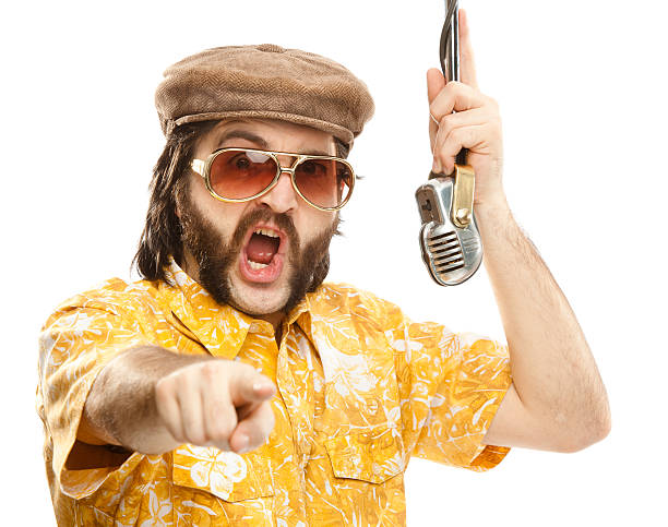 photo of a 1970s man with a hawaiian shirt and microphone - radio dj stock photos and pictures