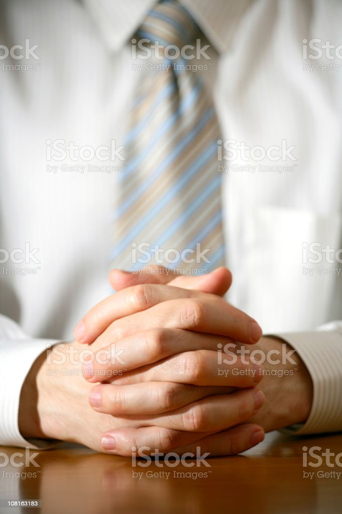 Photo of a business man with folded hands royalty-free stock photo