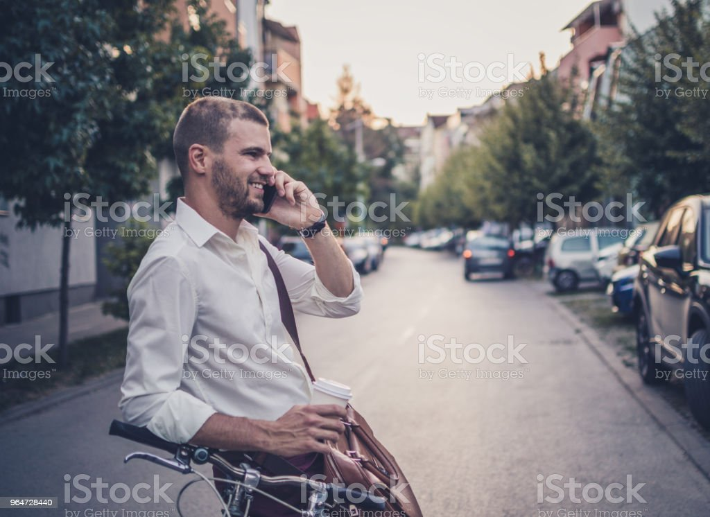 Photo of a businessman talking on mobile phone royalty-free stock photo