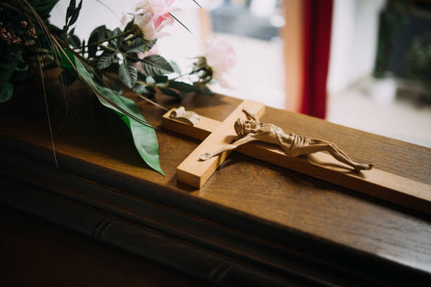 photo of a cross on a wooden casket stock photo