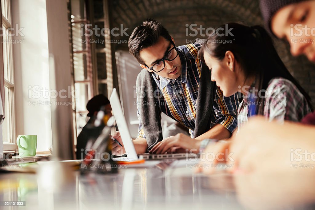 Photo of a designer team working together in office - Royalty-free 20-29 Years Stock Photo