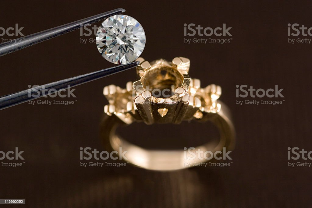 Photo of a Diamond Above an Engagement Ring stock photo