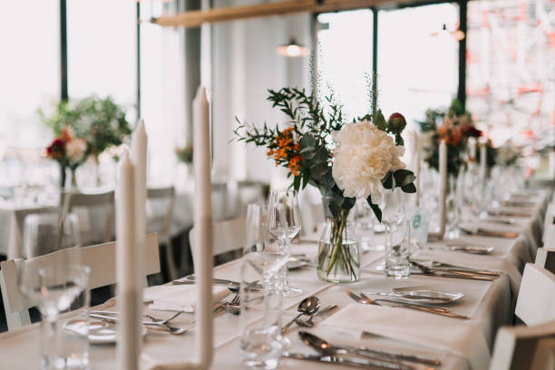 photo of a dinner table at a wedding stock photo